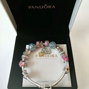 Pandora bracelet with 13 charms new in box
